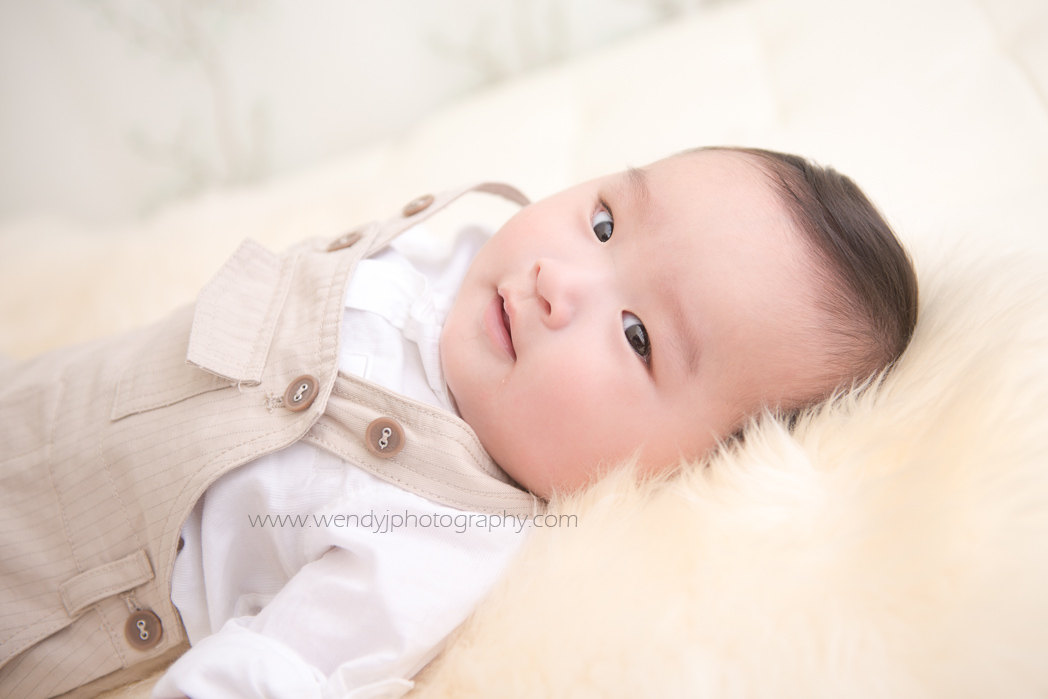 6 month old baby boy photographed by award winning child and baby photographer Wendy J.