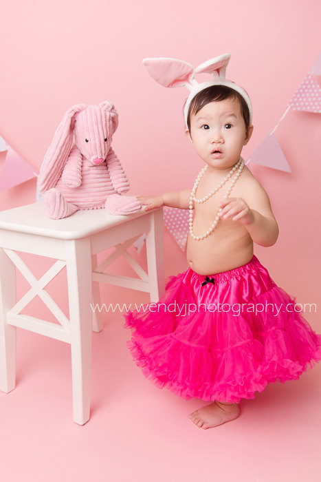 Cute 1 year old girl wearing bunny ears and tutu during a Burnaby, Vancouver B.C. child portrait photography session.